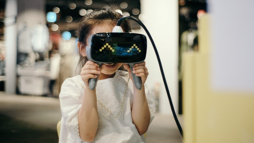 Girl looking in virtual reality viewer