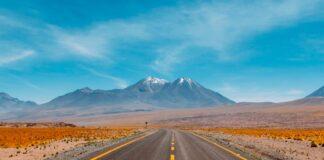 Highway through desert leading to mountains