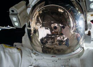 An astronaut's helmet reflecting spacecraft